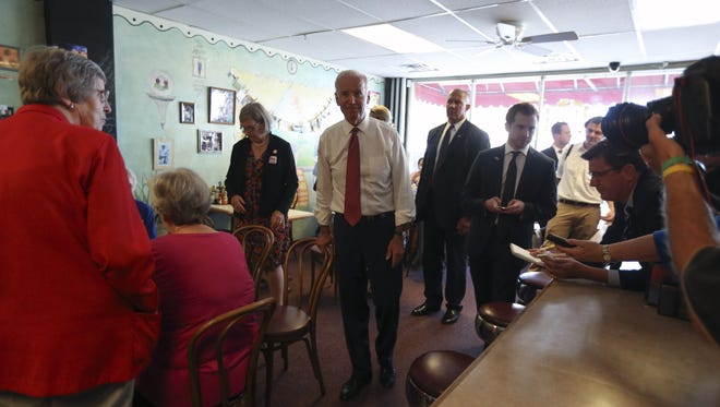 Vice President Joe Biden makes a stop at the Waveland Cafe while touring briefly with the Network Nuns on the Bus on Wednesday, Sept. 17, 2014, in Des Moines, Iowa.