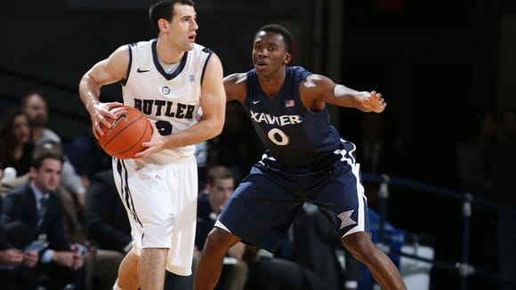 Feb 11, 2014; Indianapolis, IN, USA; Xavier Musketeers guard Semaj Christon (0) defends Butler Bulldogs guard Alex Barlow (3) at Hinkle Fieldhouse. Xavier won 64-50.