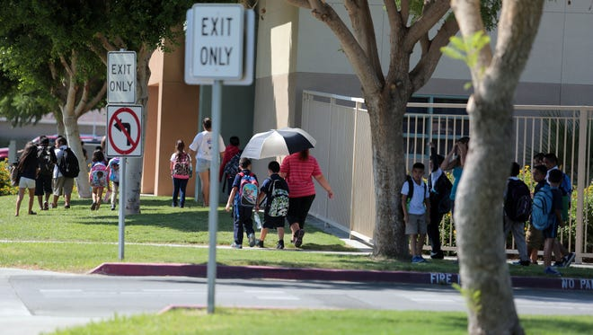 Students leave Theodore Roosevelt Elementary School after school on Thursday, September 25, 2014 in Indio.