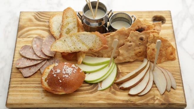 The molten fondue cheese board from The Market by Jennifer in Phoenix.