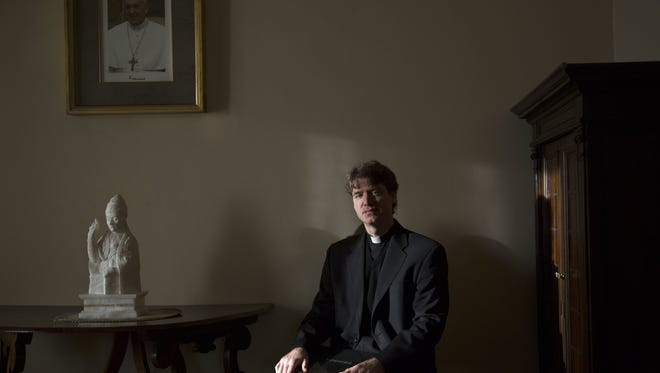 Monsignor Daniel Gallagher of Traverse City, Mich., is one of seven Vatican Latinists and translates Pope Francis' tweets into Latin under the Twitter handle @Pontifex_In.
