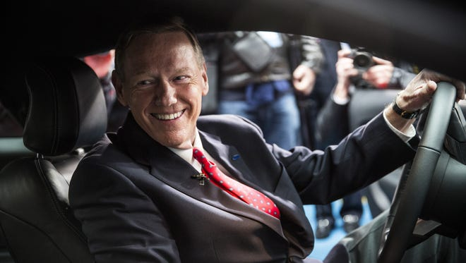 Alan Mulally, CEO of Ford, poses inside the 2015 Ford Mustang on the set of Good Morning America on December 5, 2013 in New York City.
