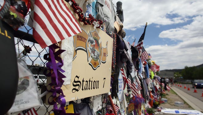 A makeshift memorial to the 19 fallen firefighters wraps around three sides of Fire Station 7 in Prescott in August, weeks after the tragedy.