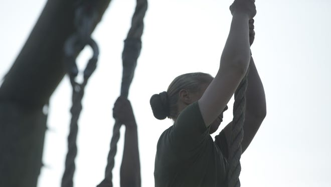 U.S. Marines from Delta Company, Infantry Training Battalion, School of Infantry-East  navigate their way through the obstacle course aboard, Camp Geiger, N.C., Oct. 04, 2013. Delta Company is the first company at center with female students.