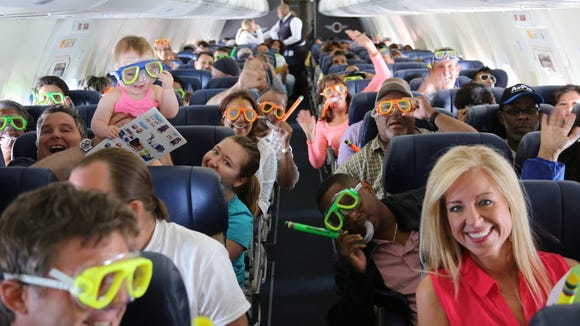 Passengers don complimentary snorkel gear that Southwest handed out on its second-ever international flight to Montego Bay, Jamaica, on July 1, 2014.