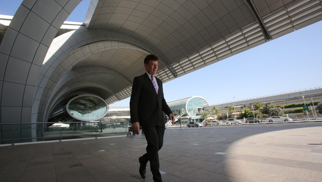 In this June 17, 2014, photo, Dubai Airports CEO Paul Griffiths, a 56-year-old Briton, walks out of the airport's Terminal 3 in Dubai.