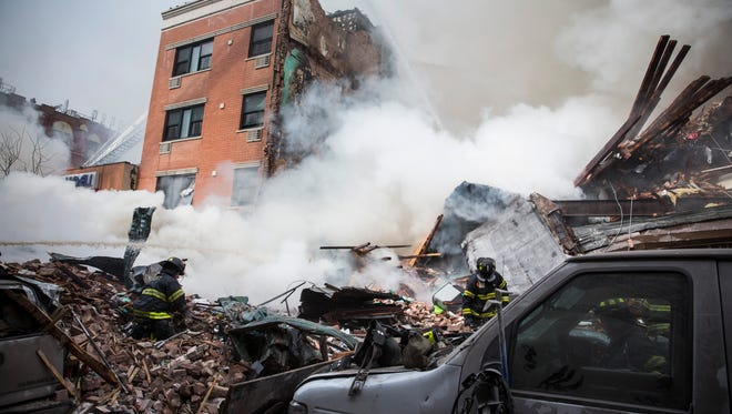 Heavy smoke pours from the debris as the New York City Fire Department responds to a building collapse at 1646 Park Ave. in East Harlem in March. A gas leak likely triggered an explosion that flattened two apartment buildings, killing eight people and injuring more than 48.