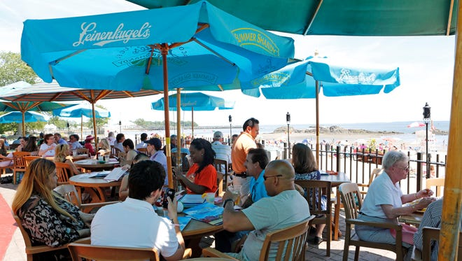 Patrons lunch on the patio at Seaside Johnnies June 20, 2014 in Rye.