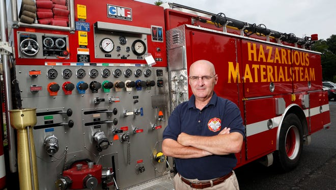 Dan Greeley, assistant director of Rockland County's Office of Fire and Emergency Services, is photographed with the hazardous materials truck that dispenses foam July 31 at the training center in Ramapo.