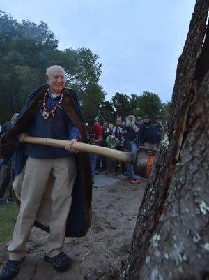 """Wearing his new chieftain medallion and cape, Tad Dukehart lights the first ceremonial bonfire of the evening for Fyr Bal in Ephraim on Saturday. The fire symbolizes the exit of winter (by burning the """"winter witch'') and the arrival of summer solstice. For more photos, visit doorcountyadvocate.com."""