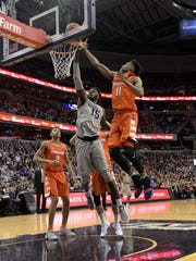 Syracuse forward Oshae Brissett shoots against Georgetown