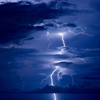 Lightning strikes over the ocean after thunderstorms