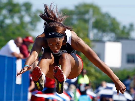 South Side's Makayla Transou leaps as she competes