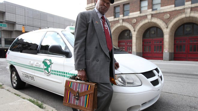 Metro Detroit Cab Drivers Association Kenneth Kabaka Reynolds next to his Green Eagle Cab that he drives  in Detroit Wednesday, October 15, 2014. He is the Secretary of Communications and Public Safety Affairs. Jessica J. Trevino/Detroit Free Press