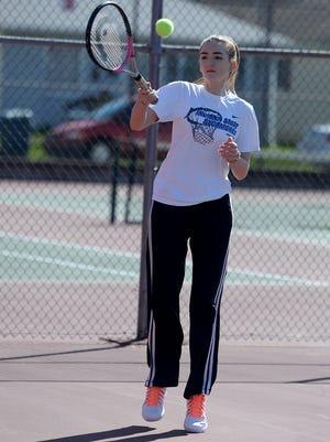 Richmond High School tennis player Marissa Wigginton practices Tuesday, March 29, 2016 at RHS.