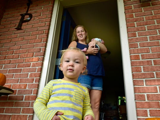Kim Pedersen spends time at home Tuesday, September 20, 2016 with her children Audrey, front, and 1-month-old Elise. Pedersen is a teen pregnancy mentor.