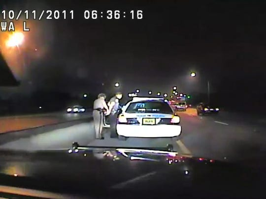 In this image made from an Oct. 11, 2011 video made available by the Florida Department of Highway Safety and Motor Vehicles, Florida Highway Patrol Officer Donna Watts arrests Miami Police Department Officer Fausto Lopez who was traveling at 120 miles per hour to an off-duty job, in Hollywood, Fla. After the incident, Watts says that she was harassed with prank calls, threatening posts on law enforcement message boards and unfamiliar cars that idled near her home.