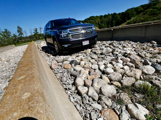 Amanda Rockhold, Manager, Customer Development, drives a Chevrolet Suburban over riverbed rock at Transportation Research Center in East Liberty, OH in September 2016.