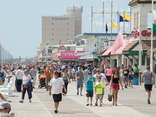 Visitors on the boardwalk at Rehoboth Beach.