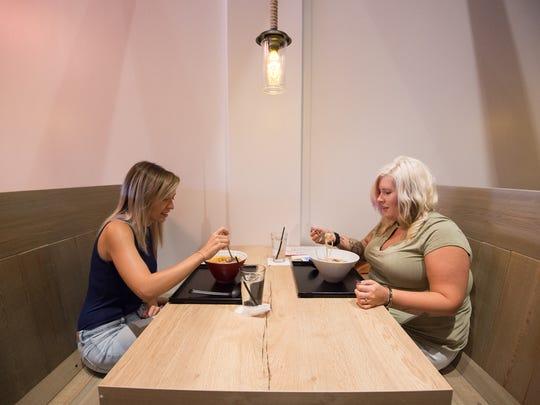 Sarah Leon, left of Lincoln and Deanea Warren of Townsend enjoy at meal at Miyagi Ramen Bar in Rehoboth.