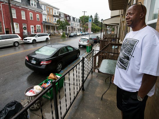 """Mark Nixon stands outside his West Jackson Street home in York. Nixon's wife, Monique, was killed in November 2013. She was an innocent bystander. The shooter fired in the area of a man he had been arguing with earlier, but struck 49-year-old Monique Nixon instead. """"The people that are running around here carrying these guns so freely — I see it all the time. ...There could be something more done about it,"""" Mark Nixon said."""