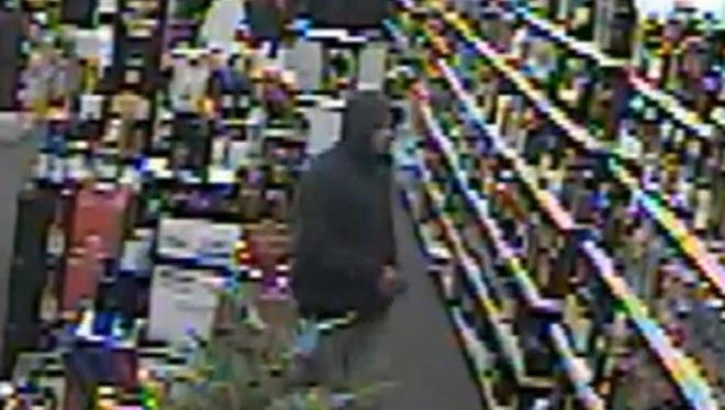 Surveillance image from a robbery at Everyday Liquor in Greece on April 4.