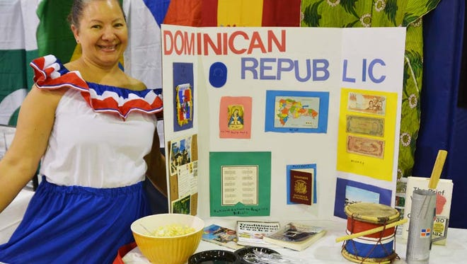 Edda Then of Bernardsville co-hosted a Dominican Republic table with foods to sample, traditional music instruments and the country's currency on display.