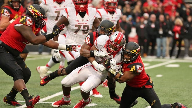 Nov 29, 2014; College Park, MD, USA; Rutgers Scarlet Knights running back Robert Martin (7) runs for a gain against the Maryland Terrapins at Byrd Stadium. Mandatory Credit: Mitch Stringer-USA TODAY Sports