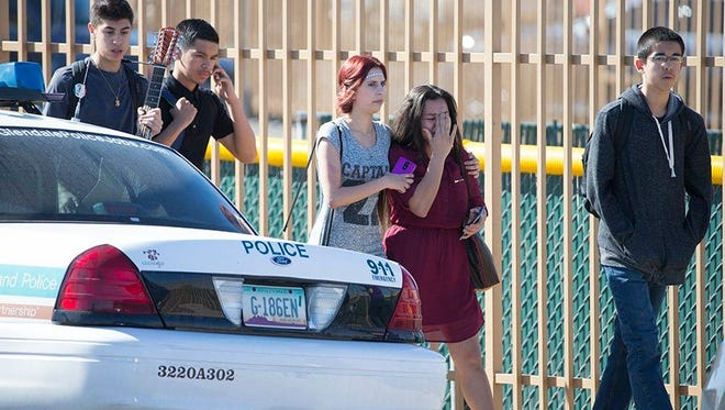 Students leave Glendale Independence High School following a double shooting on Feb. 12, 2016 that left two 15-year-old girls dead.
