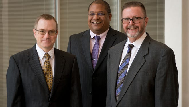 "Christopher M. Gatton (left) and Jesse Jacobus (center) were became partners in the Law Office of George ""Dave"" Giddens (right) last year. The firm's name was changed to Giddens, Gatton & Jacobus, P.C., to reflect their roles in the firm"