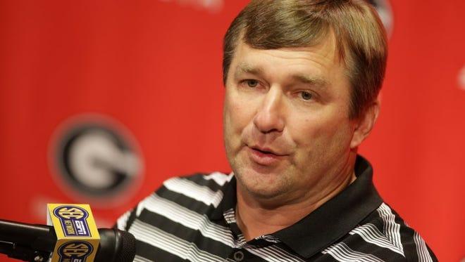 Georgia's Kirby Smart begins his first season as a head coach Saturday against North Carolina.