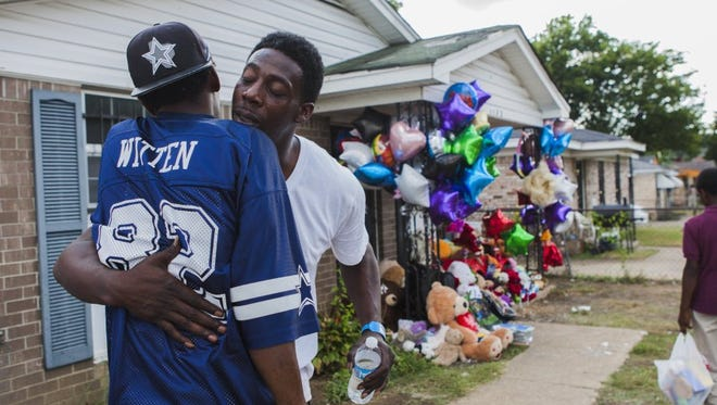 Ernest Jett Jr. (right) hugs his first cousin Roosevelt Henderson in Memphis on Sept. 14, 2016, at the site where his children, mother, girlfriend and family friend were killed in a house fire on Monday.