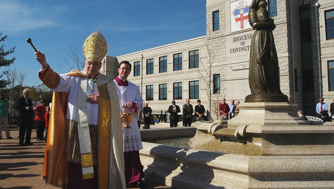 Diocese of Covington Bishop Roger J. Foys, seen here blessing attendees of the St. Mary's Park blessing and dedication in 2016 in Covington, has ordered a review of priest files with an eye toward any potential sex abuse, according to an article in the Nov. 15, 2019, Diocese-run publication the Messenger.