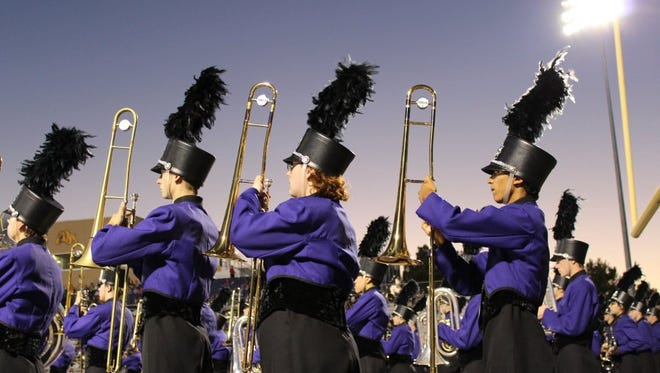 "Wylie High trombonists, from left, Brandon Walker, Tyler Roberts and Xavier Taylor are ready to march onto the field for their performance of ""The Story of Our Home"" at the 23rd Big Country Marching Festival earlier this month."