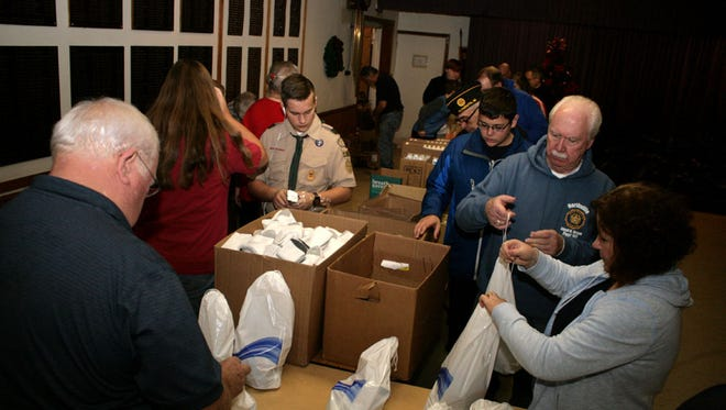 Volunteers wrapped nearly 900 gifts for veterans in just 90 minutes.
