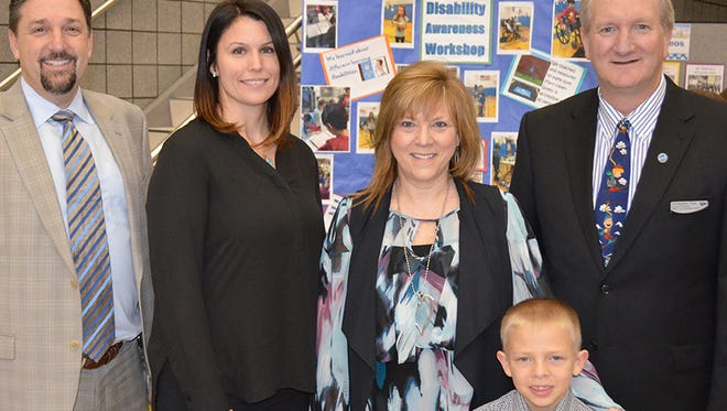 Kenneth Gutman (from left), Walled Lake superintendent; Meagan Granberry, 2017 Friend of Diversity Award recipient; Michelle Fiebke-Lang, Mary Helen Guest Elementary School principal; Hayden House, 2017 Friend of Diversity Award recipient; and Christopher Titus, WLCSD Board of Education president.