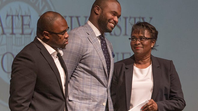 Myron Rolle with brother and mother during the Match Day Ceremony.