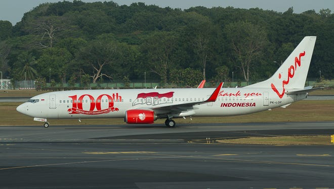 The 100th Boeing 737NG for Indonesia-based Lion Air taxis to the runway at Singapore Changi International Airport in February 2014.