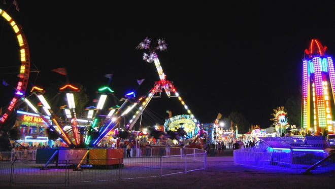 Rides light up the midway at a prior year's Boone County 4-H & Utopia Fair, which has been canceled in 2020 due to COVID-19.