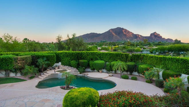 Raj Rathee, an OB/GYN at Estrella Women's Health Center, and his wife Jyotsna, aninternal medicine specialist at Estrella Women's Health Center, purchased this mansion inParadise Valley's Invergordon Heights. The four-bedroom and five-bathroom, 7,504-square-footestate boasts amazing views of Camelback Mountain. The home features dramatic pillars framing theentryway, a grand foyer with a tiered ceiling and bay windows in the dining room. The kitchen is fitted with honey-hued hardwood cabinetry, gorgeous granite counter tops and has a chandelier-lit breakfast room. The home also features an exercise room/office and a pub-style game room/billiards parlor. The backyard is its own oasis, with lush lawns, immaculately manicured shrubbery, an alfresco barbecue island, expansive dining patios, a private pool and elevated spillover spa. Thomas Buis, general manager at Showcase Honda, and his wife, Deborah, sold the home through their trust.
