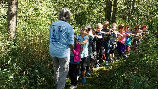 The Green Gift from Cellcom will support the Cottonwood Trail program, which brings first-graders in Manitowoc, Brown, Sheboygan and Kewaunee counties to Woodland Dunes and teaches them in the place-based system.