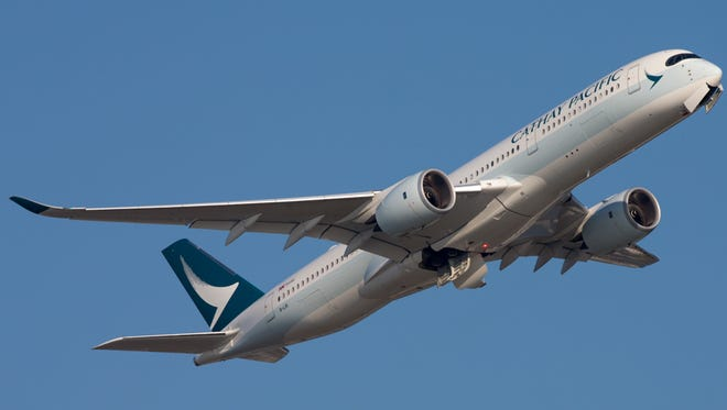 A Cathay Pacific Airbus A350 takes off from Hong Kong in August 2017.