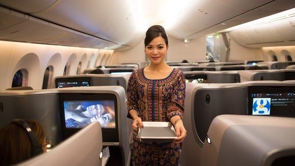 A flight attendant readies for service aboard Boeing's