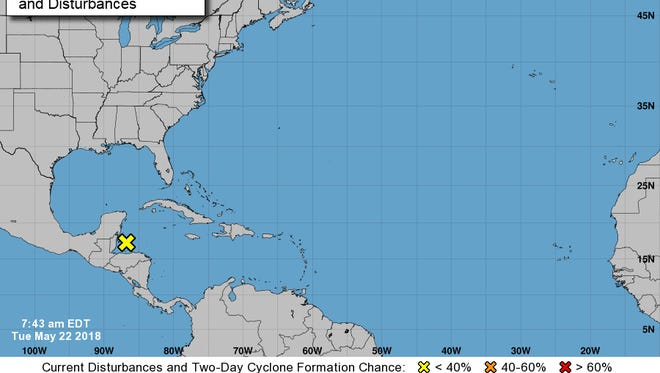 A disturbance off the coast of Belize has a strong chance of moving into the Gulf of Mexico and developing into a tropical disturbance.