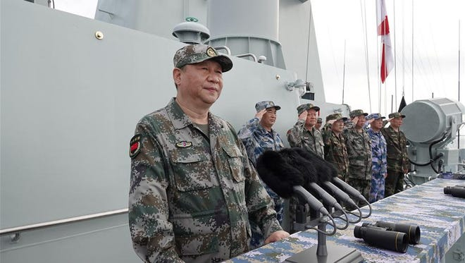 Chinese President Xi Jinping oversee's the country's largest military drill in modern history in April 2018. The drill took place in the South China Sea with 76 fighter jets and 48 warships participating.