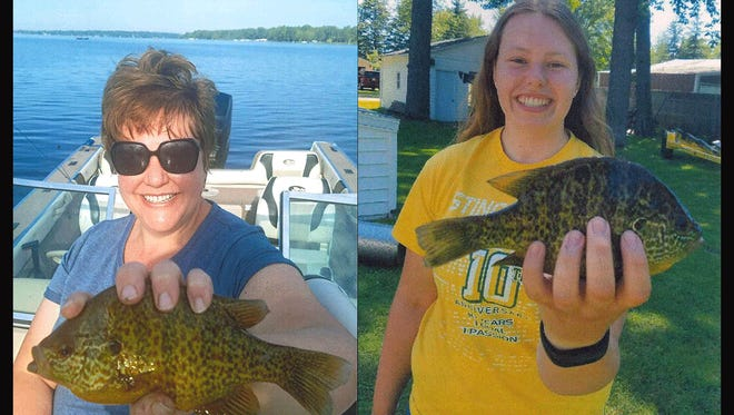 Brenda Carter, left, holds a 9-inch pumkinseed sunfish she caught July 3 on Lake Noquebay. The fish established the Live Release record for Wisconsin, breaking the mark set by an 8.75 inch pumkinseed caught in 2017 by her daughter, Erika Carter,