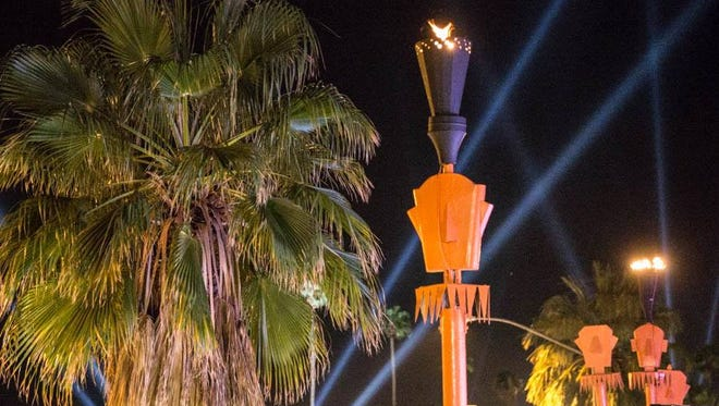 Rooftop tiki torches burn Sunday at The Twist building in uptown Palm Springs.