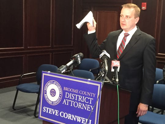 Broome County District Attorney Steve Cornwell holds