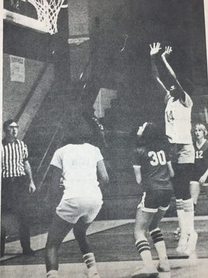 Yvette Braden aims to score against Daviess County in January 1980. The Bravettes played well in the first half, but were defeated in the second half of the game.
