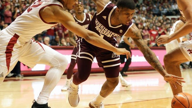 Jan 20, 2018; Tuscaloosa, AL, USA; Mississippi State Bulldogs guard Lamar Peters (1) goes for the ball along with Alabama Crimson Tide guard Dazon Ingram (12) during the first half at Coleman Coliseum. Mandatory Credit: Marvin Gentry-USA TODAY Sports
